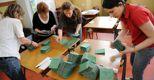 Scrutatori preparano le schede in un seggio elettorale di Milano per il voto amministrativo del 15 e 16 maggio (Ansa)