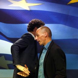 Il capo dell'Eurogruppo Jeroen Dijsselbloem (s) e il ministro delle Finanze greco Yanis Varoufakis  (REUTERS)