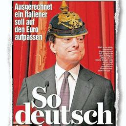 """""""Il nuovo capo della BCE è così tedesco"""". Un regalo speciale per il nuovo presidente della Bce: un elmo prussiano a punta originale del 1871, consegnato dal direttore del Bild Kai Diekmann. La motivazione è quella di ricordare agli italiani le virtù prussiane. Mario Draghi l'ha presa con umorismo..."""