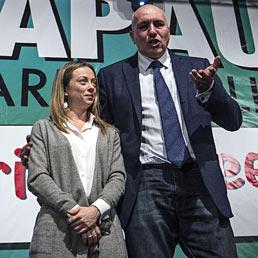 """Nella foto Giorgia Meloni con Guido Crosetto al convegno elettorale """"Le primarie delle idee"""" all'auditorium Concillazione a Roma (Ansa)"""