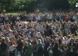 75 anni Lennon, catena di pace a Central Park